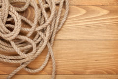 Ship rope on old wooden texture background Stock Photo