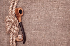 Ship rope, seashells and tobacco pipe Royalty Free Stock Image