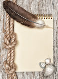 Ship rope, shells, feather, notebook and old wood Stock Image