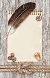Ship rope, shells, feather, notebook and wood background Stock Image