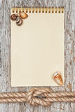 Ship rope, shells, notebook and wood background Royalty Free Stock Photography