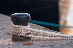 Ship rope tied to a harbor Stock Photos