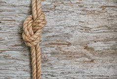Ship rope and wood background Stock Images