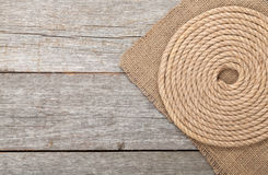 Ship rope on wood and burlap Royalty Free Stock Images