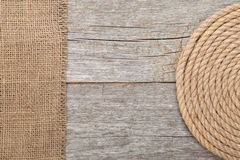 Ship rope on wood and burlap Stock Images