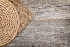 Ship rope on wood and burlap Royalty Free Stock Image
