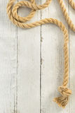 Ship rope on wood Stock Photo