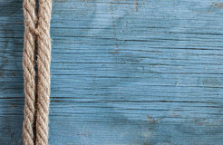 Ship rope on wooden background Stock Images