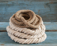 Ship rope on wooden background Stock Image