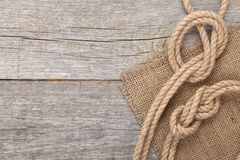 Ship rope on wooden texture background Stock Images