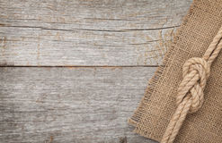 Ship rope on wooden texture background Royalty Free Stock Images