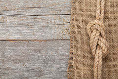 Ship rope on wooden texture background Royalty Free Stock Photos