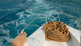 Ship rope on the yacht on background of ocean water Royalty Free Stock Image