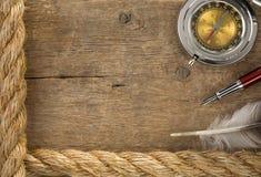 Ship Ropes And Compass At Old Wood Royalty Free Stock Image