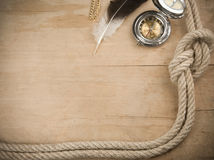 Ship Ropes And Compass On Wood Stock Photography