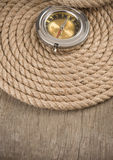 Ship Ropes And Compass On Wood Royalty Free Stock Image