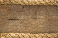 Ship ropes borders on wood background. Texture Royalty Free Stock Photo