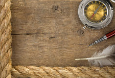 Ship ropes and compass at old wood Royalty Free Stock Image