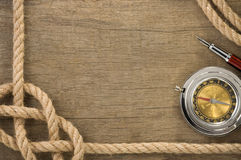 Ship ropes and compass at old wood Royalty Free Stock Photography