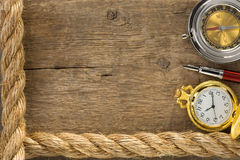 Ship ropes and compass with pen on wood. Ship ropes and compass with pen on old vintage wooden background Royalty Free Stock Photos