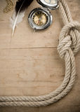 Ship ropes and compass on woo Stock Photography