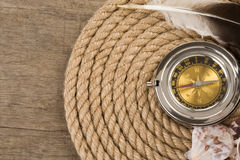 Ship ropes and compass on wood Stock Photo