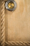 Ship ropes and compass on wood Royalty Free Stock Images