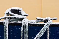 Ship ropes covered with snow in winter Royalty Free Stock Photos