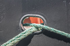 Ship ropes. Ship docking ropes against black metal ship surface Royalty Free Stock Images
