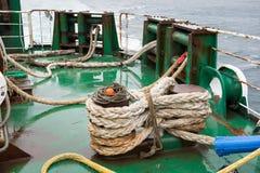 Ship ropes folded on a ship Royalty Free Stock Image
