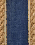 Ship ropes on jeans background Stock Images