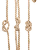 Ship ropes with a knot Royalty Free Stock Photo