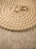 Ship ropes and knot on wood Stock Photos