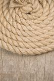 Ship ropes and knot on wood texture Royalty Free Stock Image