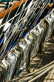 Ship ropes. Ropes laying upon ropes on a wooden ship Royalty Free Stock Photos