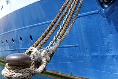Ship and ropes. Moored old ship with chain and ropes in the port royalty free stock images