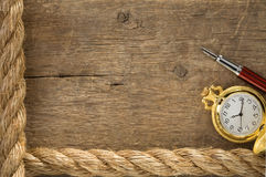 Ship ropes and watch with ink pen on old wood Royalty Free Stock Image