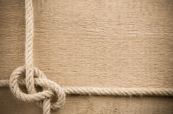 Ship ropes on wood background Stock Photography