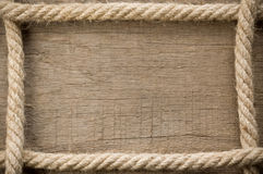 Ship ropes on wood background Royalty Free Stock Images