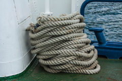 Ship rough rope roll on deck of vessel Stock Photo