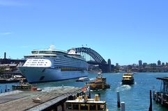 Ship of Royal Caribbean Cruise with Harbour Bridge, NSW. View of Royal Caribbean Cruise at waterfront on Harbour Bridge at Australia Stock Photo