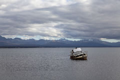Ship run aground at fagnano lake. Tierra del fuego. Argentina royalty free stock images