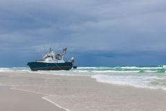 Ship run onto a sandbank Royalty Free Stock Photography