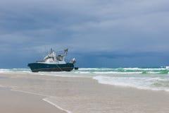 Ship run onto a sandbank. The ship runs during a storm onto a sandbank on Fraser Island, Australia. Fraser Island is the biggest sand island in the world royalty free stock photography