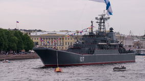 Ship of the Russian Navy. A warship moored in the city center. On masts waving flags holidays stock video