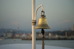 Ship`s bell. In the background of the sea port Royalty Free Stock Image