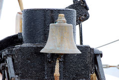 Ship's bell. Closeup of a ship's bell and rope on the deck of a sailing boat Royalty Free Stock Photography