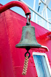 Ship s Bell. Bell hanging on the superstructure of the ship firefighting Royalty Free Stock Photo