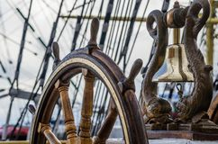 Ship Bell and wheel the old sailboat. Close up stock images