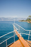 Ship's bow. And coastline royalty free stock image